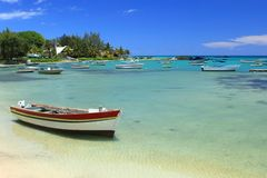 Fishing boats in shallow water, Mauritius Stock Photo