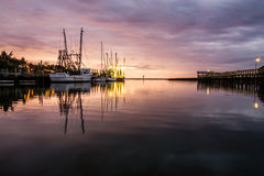 Fishing Boats at Shem Creek. Sunset over Shem Creek in Mount Pleasant, South Caroilna with the fishing boats at the docks Royalty Free Stock Photography
