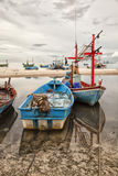 Fishing boats on shore Stock Image