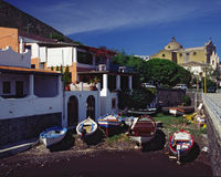 Fishing boats on the shore. In between buildings in the town of Santa Marina in Italy Royalty Free Stock Images