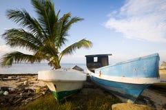 Fishing boats on shore caribbean sea stock photos