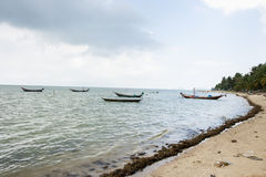 Fishing boats on shore, Koh Pha Ngan, Thailand Stock Photo