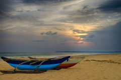 Fishing boats on the shore of the ocean Stock Photography