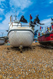 Fishing boats on the shore, pebble beach, wooden boats, fishing Stock Images