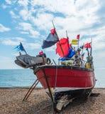 Fishing boats on the shore, pebble beach, wooden boats, fishing Stock Photos