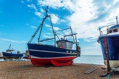 Fishing boats on the shore, pebble beach, wooden boats, fishing Royalty Free Stock Photos