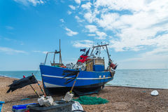 Fishing boats on the shore, pebble beach, wooden boats, fishing Stock Image