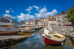 Fishing boats on the shore in Perast town stock images