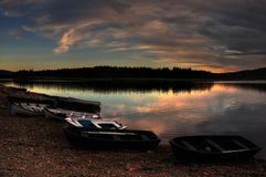 Fishing boats on the shore of the scottish lake Royalty Free Stock Image