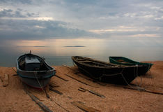 Fishing boats on the shore of the sea. Fishing boats on the shore of the Azov Sea Kazantip Bay Royalty Free Stock Photography