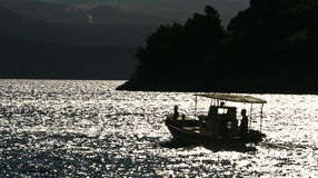 Fishing boats silhouette in the  Peloponese Royalty Free Stock Photos