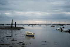 Fishing boats and small boats at low tide in UK Royalty Free Stock Photos