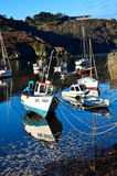 Fishing boats in a small harbour Stock Image
