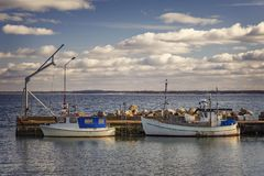 Fishing boats in small harbour Stock Image