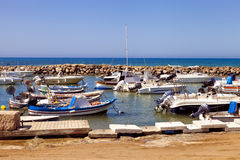 Fishing boats in a small Italian harbour Stock Photography