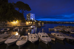 Fishing boats in small mediterranean port at dusk Royalty Free Stock Image
