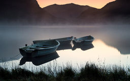 Fishing boats. Small fishing boats moored up at Llyn Nantlle , North Wales stock image