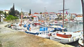 Fishing Boats. Some fishing boats docked at the Old Harbour, in Spetses island. Has been taken on HDR settings on a smarthphone stock images