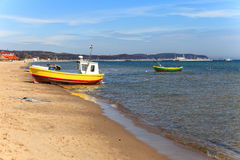 Fishing boats in Sopot. Fishing boats on the background of the pier in Sopot, Poland Stock Photography