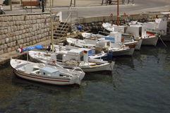 Fishing Boats at Spetses. A fleet of fishing boats tied to the sea wall at Spetses Royalty Free Stock Photo