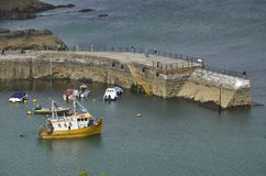 Fishing Boats in St. Austell near the Harbour Entrance. Fishing Boats moored near the Harbour Entrance of Mevagissey, St. Austell Stock Photo