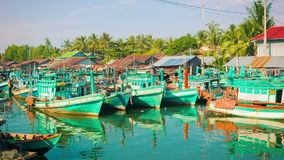 Fishing boats stand in the river mouth stock video footage