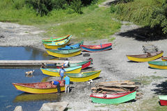 Fishing boats standing on river shore Stock Image