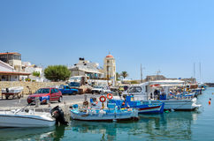 Fishing boats stay parked at port of Ierapetra town on Crete island, Greece Royalty Free Stock Image