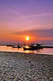 Fishing boats and sun rise Stock Photo