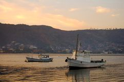 Fishing boats at sunrise Royalty Free Stock Image