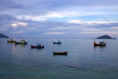 Fishing boats at Sunrise. Fishing boats anchored off Vietnam at Sunrise Stock Image