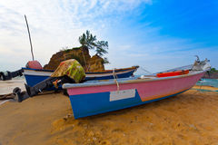 Fishing Boats and Sunrise. Traditional fishing boats at stranded on beachin Kijal, Trengganu, Malaysia Stock Image