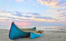 Fishing boats and sunrise Stock Photo