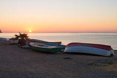 Fishing boats at sunrise Stock Photos