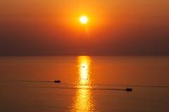 Fishing boats at sunrise. Stock Photo