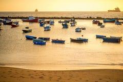 Fishing boats on the sunrise Stock Photos