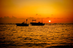Fishing Boats Sunset. Two fishing boats silhouette on Tartous, Syria Royalty Free Stock Images
