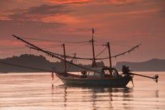 Fishing boats at sunset. Thailand Stock Photos