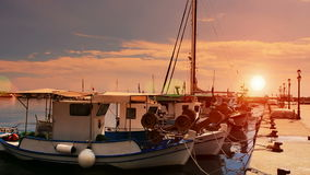 Fishing boats at the sunset. Fishing boats anchored in a peaceful Mediterranean port at the sunset,video clip stock video