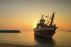 Fishing boats and sunset Stock Image