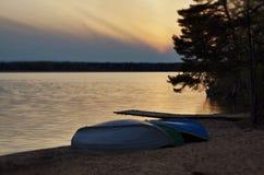 Fishing boats and sunset. Fishing boats and beautiful golden sunset near lake Stock Images
