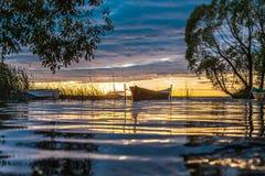 Fishing boats at sunset Stock Photos