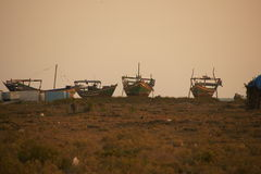 Fishing boats in the sunset Stock Photo