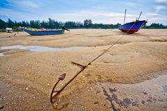 Fishing Boats Sunset in Malaysia. Traditional fishing boats at a small bay in Kijal, Trengganu, Malaysia Stock Images