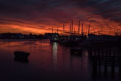 Fishing boats at sunset in Marina. In Beaufort NC Royalty Free Stock Image