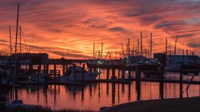 Fishing boats at sunset in Marina. In Beaufort NC Stock Photos