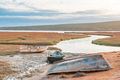 Fishing boats at sunset in the Olifants River estuary Stock Photo