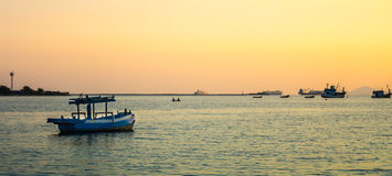 Fishing boats at sunset. Royalty Free Stock Photos