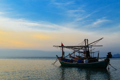 Fishing boats at sunset or sunrise Royalty Free Stock Images