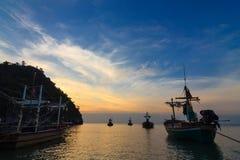 Fishing boats at sunset or sunrise Stock Image